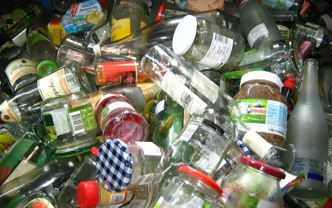glass bottles in bin