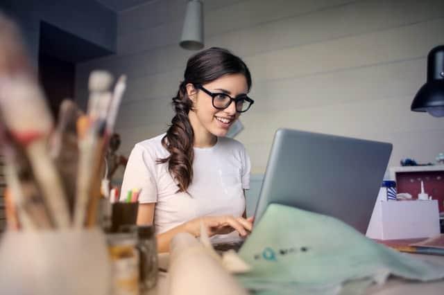 happy woman at computer